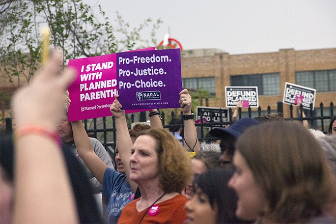Planned Parenthood supporters at a rally in April. - DANNY WICENTOWSKI