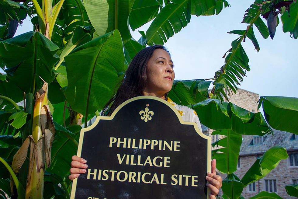 In Concordia Seminary, on the edge of what used to be the Philippine Village, Langholz displays the sign she carries during tours of the site -- a temporary marker, for now. - DANNY WICENTOWSKI