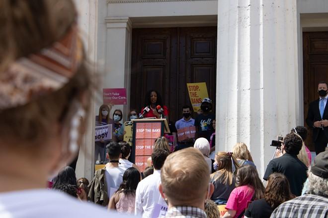 St. Louis Mayor Tishaura Jones speaks as over 100 people gather to rally for abortion access. - JENNA JONES