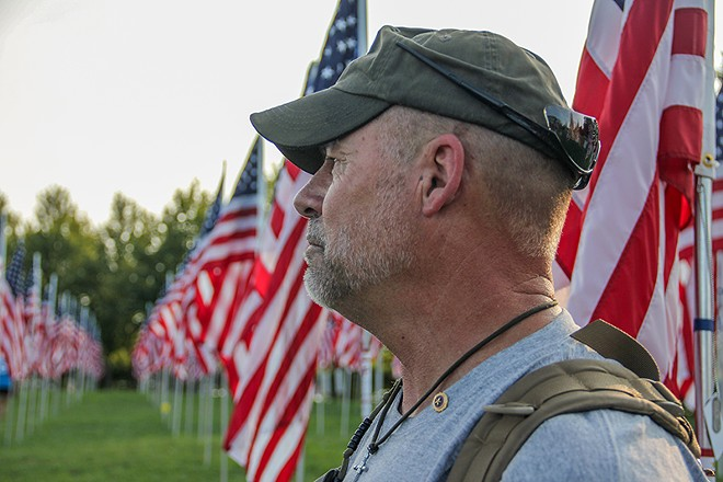 """""""Every time I touch a flag, it's like every fiber, every stitch, is another veteran that has lost their lives,"""" Presson says. - DANNY WICENTOWSKI"""