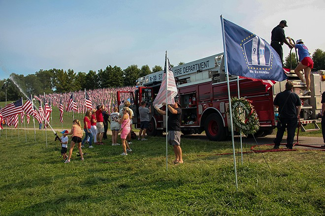 """St. Louis Fire Department trucks were on-site for the """"Flags of Valor"""" memorial on Art Hill this week. - DANNY WICENTOWKSI"""