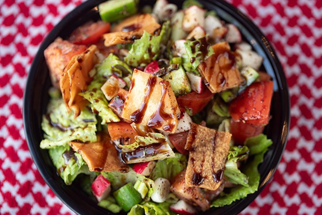 Fattoush salad with romaine, tomatoes, cucumbers and green onions, topped with pita chips, olive oil lemon dressing and pomegranate molasses. - MABEL SUEN