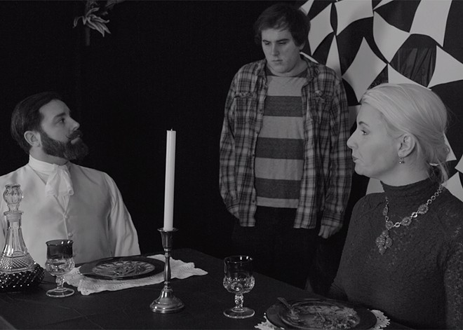 """""""Casey"""" (Casey Paulsen, center) attempts to serve """"The Lord"""" and """"The Lady"""" in the film Part Time. - COURTESY OF STRYKER SPURLOCK"""