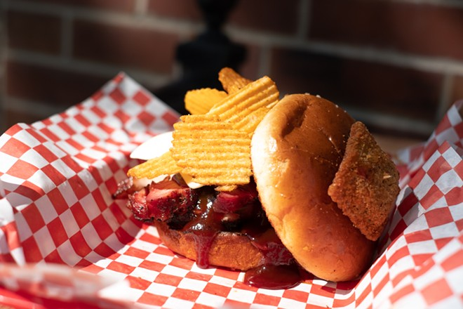 """""""The Lou"""" sandwich is made with barbecued pork steak and topped with Red Hot Riplets. - PHUONG BUI"""