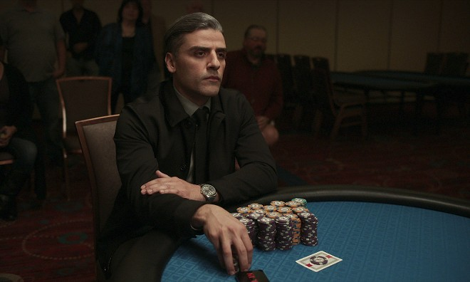 Oscar Issac stars as brooding gambler William Tell in The Card Counter. - COURTESY OF UNIVERSAL PICTURES/FOCUS FEATURES