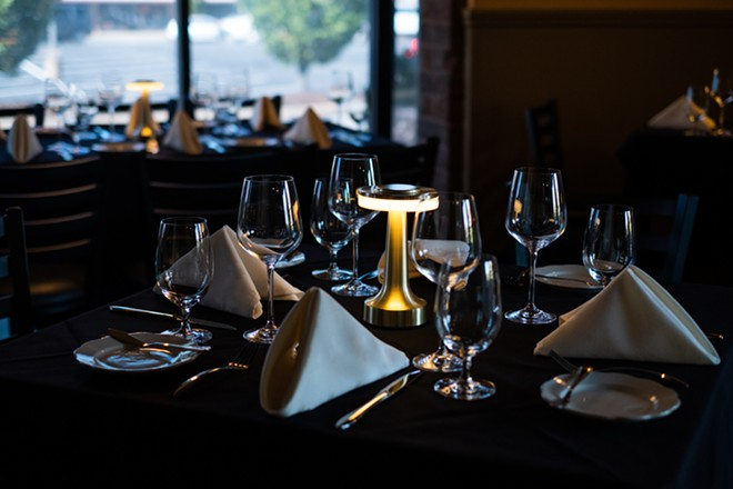 The dining room has the quintessential fine-dining feel. - PHUONG BUI
