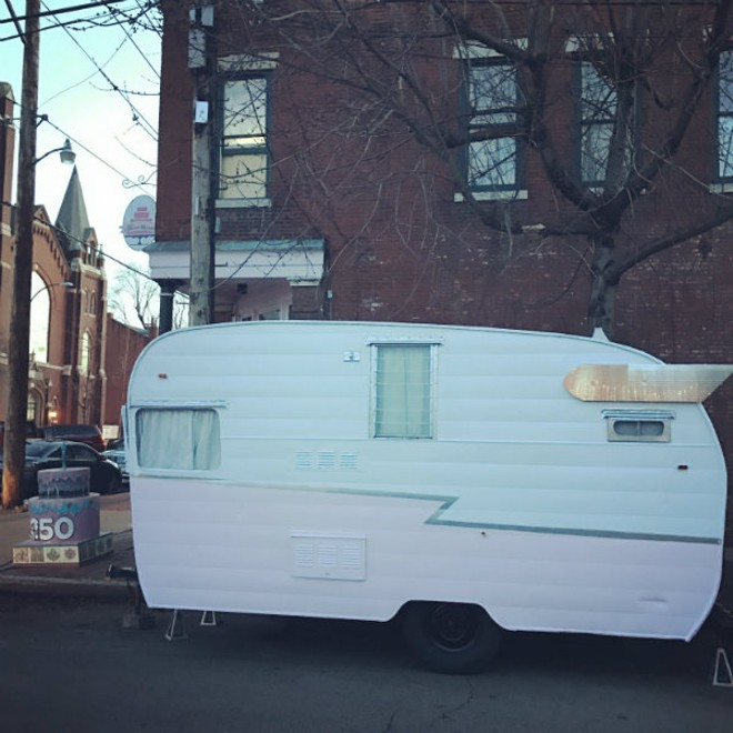 Sweet Divine now has a vintage trailer for wedding cake consultations. It is parked outside the Soulard storefront during its renovations. - PHOTO COURTESY OF JENNA SIEBERT.