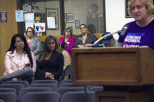 Thrive President Bridget Van Means (far left, in pink jacket) listens as a Parkway parent criticizes the Best Choice sex-ed program. - PHOTO BY DANNY WICENTOWSKI