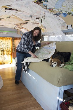 Jamie and Lucy map their upcoming bus adventure. - PHOTO BY ALLISON BABKA