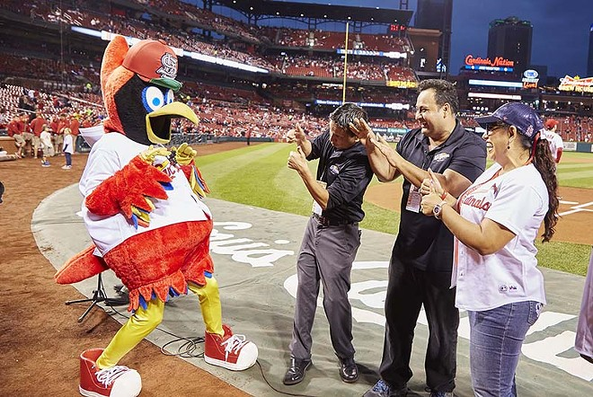 La Ke Buena DJs Tiburon (left) and Rubén Pérez (center) meet Fredbird  in 2016 on the infield at Busch Stadium. - PHOTO BY STEVE TRUESDELL