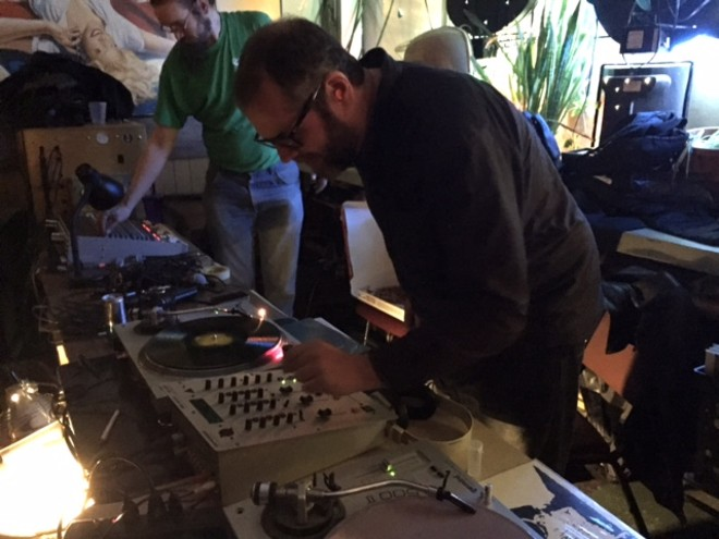 DJ Jeff Hess spins records between sets - PHOTO BY JAIME LEES