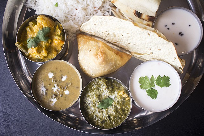 Yogi thali includes vegetable korma, palak paneer, dal makhani, naan, rice, raita and kheer. - MABEL SUEN