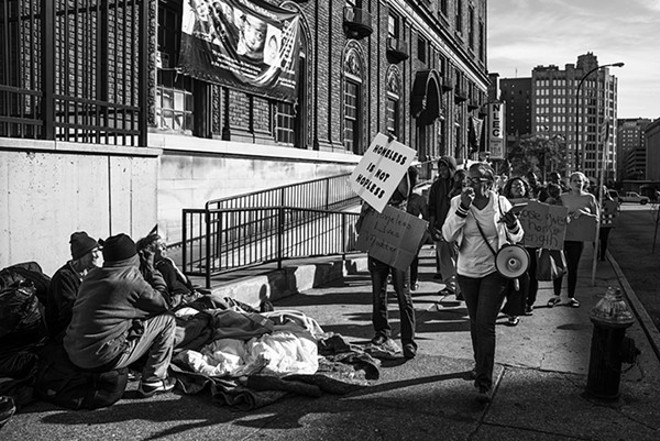Advocates protest the closure of New Life Evangelical Center last year. Many residents were moved to a warehouse last week after the city finally shut down the shelter. - PHOTO BY NICK SCHNELLE