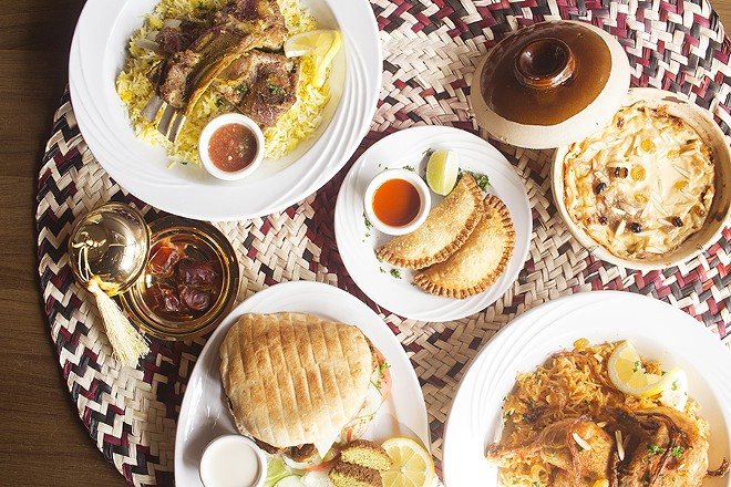 A selection of dishes from the Palm Trees: Kabli Hijazi lamb, Om Ali, Kabsa chicken, sambusas, Mandi lamb and the falafel sandwich. - PHOTO BY MABEL SUEN