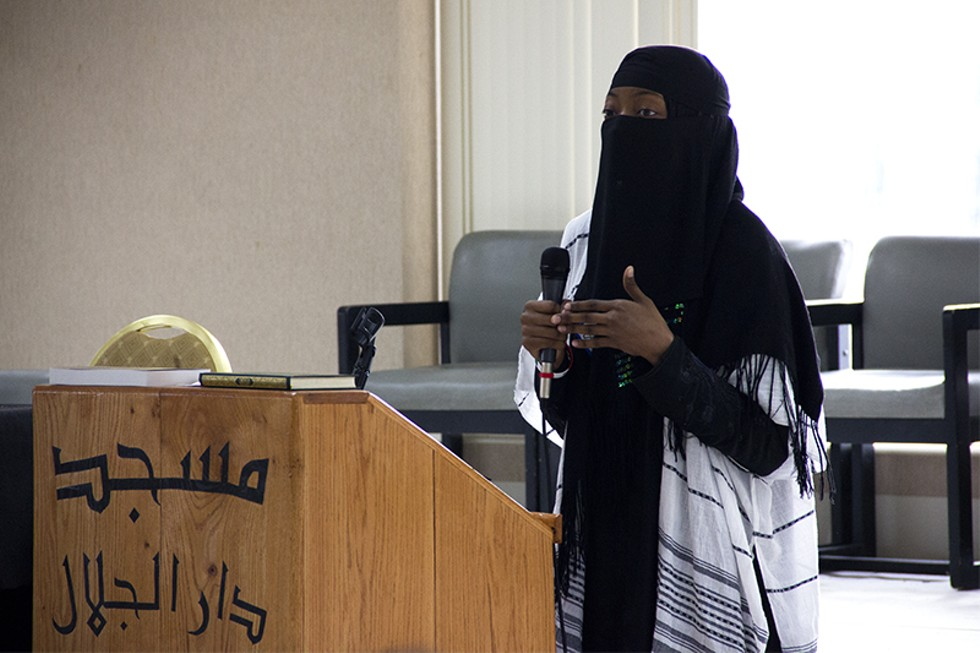 """Sandi Bowers, a St. Louis elementary school teacher and member of CAIR-Missouri's team of """"Muslim Speakers,"""" addresses the visitors to the March 26 open house. - PHOTO BY DANNY WICENTOWSKI"""