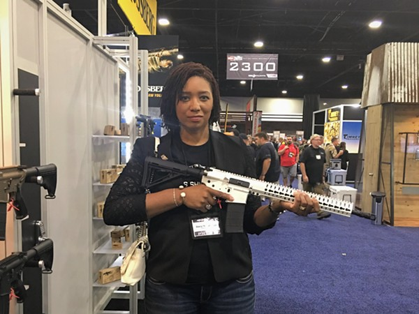 Former Post-Dispatch freelance columnist Stacy Washington, shown here at at the recent NRA convention in Atlanta. - PHOTO COURTESY OF STACY WASHINGTON