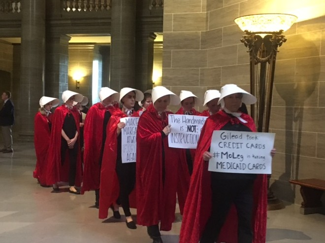 Women protesting at the legislature took a page out of Margaret Atwood's A Handmaid's Tale - COURTESY OF ALISON DREITH