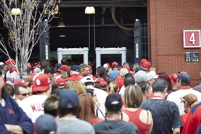 Fans line up to enter Busch Stadium on opening day in 2015. - THEO WELLING