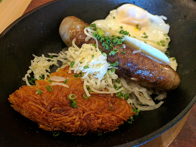 The Bavarian sausage comes with crispy potatoes, sauerkraut and your choice of eggs. - PHOTO BY DANNY WICENTOWSKI