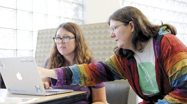 """""""It's a joy to see them light up with ideas, questions and confidence,"""" engineer Jenny Brown says of the women she mentors through CoderGirl. - PHOTO BY KELLY GLUECK"""