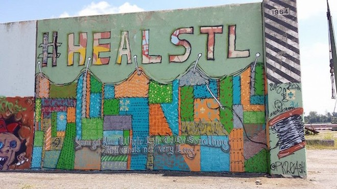 Megan Rieke painted this mural after Michael Brown's death in Ferguson. - COURTESY OF JAMES BRADY