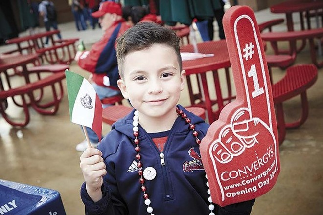"""A young Cardinals' fan shows off his Mexican pride at """"Fiesta Cardenales."""" - PHOTO BY STEVE TRUESDELL"""