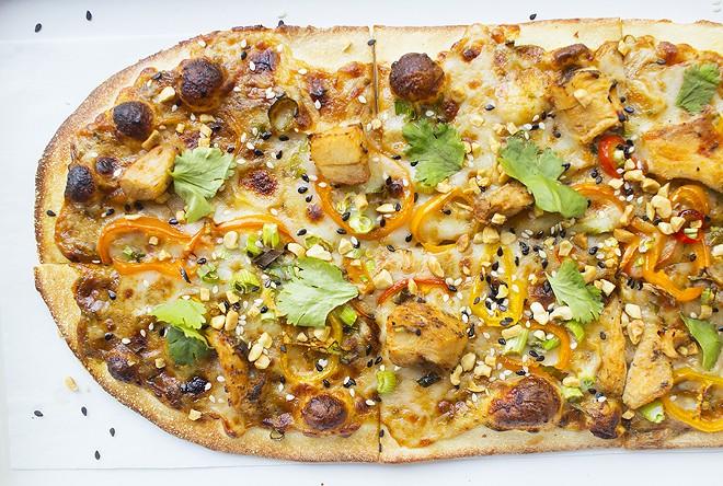 "The ""Thai Dye"" features spicy peanut sauce, mozzarella, sweet pepper, chicken, peanuts, sesame mix, garlic and cilantro. - PHOTO BY MABEL SUEN"