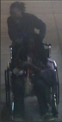 The suspect being pushed in a wheelchair. - IMAGE VIA SLMPD