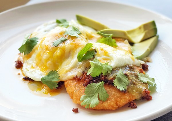 AREPA - A GRILLED CORN CAKES WITH CHORIZO, OVER-EASY EGGS, CHEDDAR, AVOCADO AND CHILI VERDE   SARA GRAHAM
