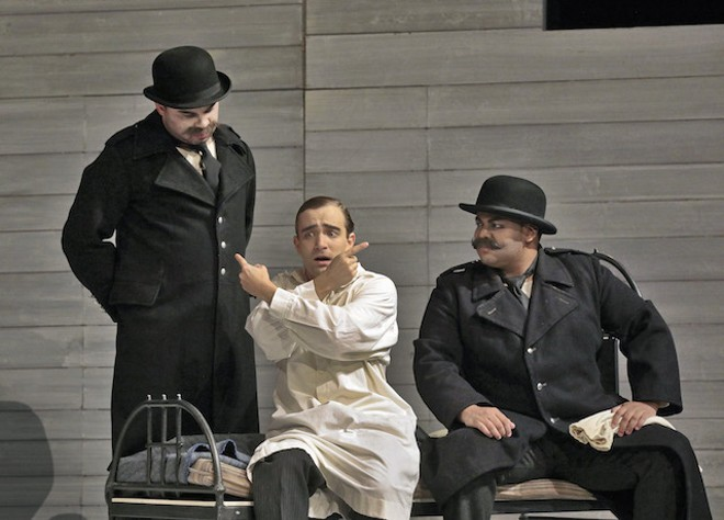 Robert Mellon (left) and Joshua Blue (right), with Theo Hoffman, provide the comic relief as a pair of corrupt guards. - PHOTO (C) KEN HOWARD, 2017