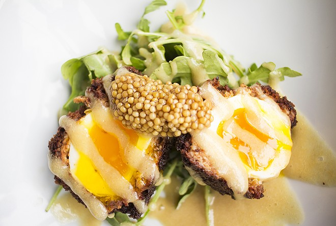 The Scotch egg, served with pickled mustard-seed vinaigrette and arugula, is a standout. - PHOTO BY MABEL SUEN