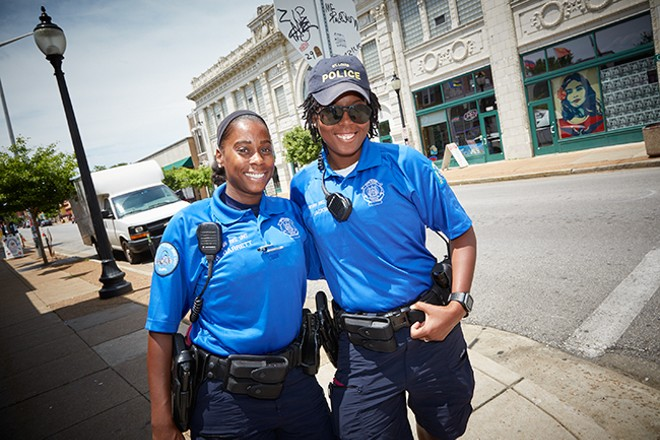St. Louis Metropolitan Police officers Jazmon Garrett and Devin Jackson work the beat on Cherokee, trying to build relationships with residents. - PHOTO BY STEVE TRUESDELL