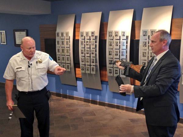 Acting police chief Lt. Col. Lawrence O'Toole (left) describes the rifle he says a suspect used to shoot at police. - IMAGE VIA SLMPD TWITTER