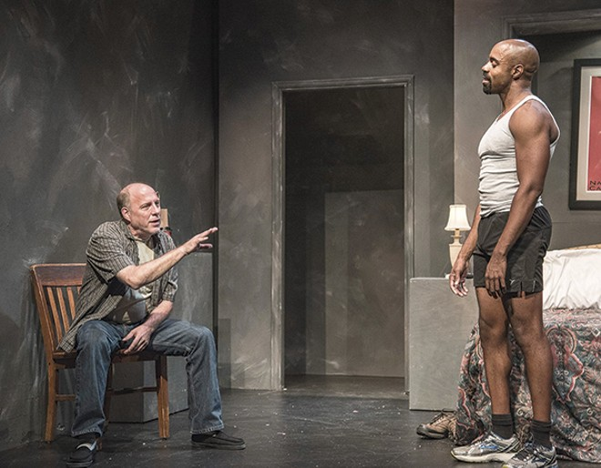 "Two men (Greg Hunsaker and Chauncy Thomas) plan a murder in Neil LaBute's ""Hate Crime."" - PATRICK HUBER"