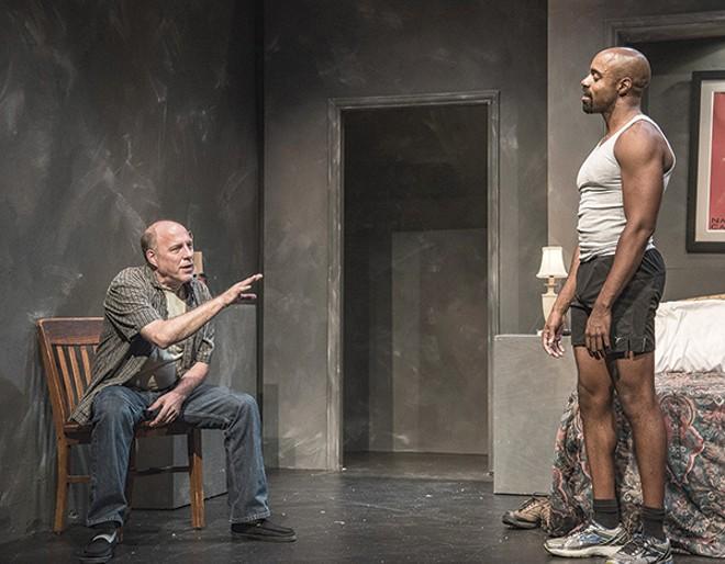 "Two men (Greg Hunsaker and Chauncy Thomas) plan a murder in Neil LaBute's ""Hate Crime."" - PATRICK HUBER"