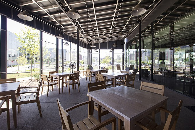 A large enclosed patio provides additional seating. - MABEL SUEN