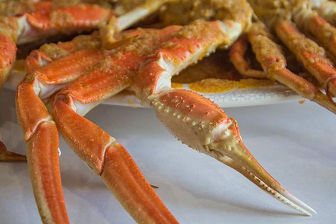 Crab legs, coated in seasoning. - PHOTO BY SARA BANNOURA