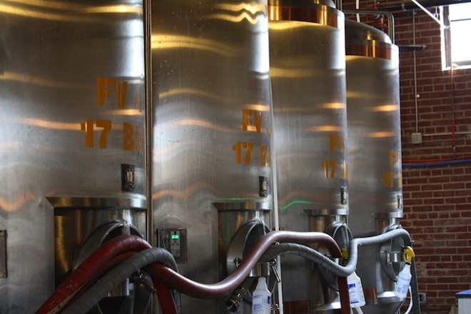 The brewery uses a seven-barrel system to craft its beer. - PHOTO BY BILL LOELLKE