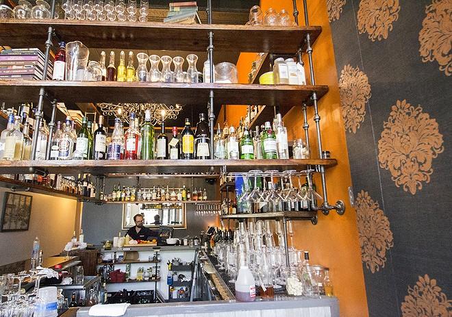 Travis Hebrank at work at the bar. - MABEL SUEN