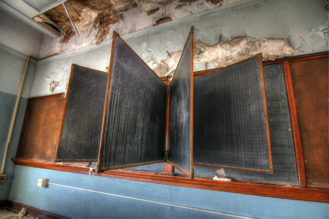 """The Boardroom,"" was taken at Simmons school, which was built in 1899 and closed in 2009. It is part of the new photo exhibit, ""Empty Halls, Silent Classrooms,"" which will open in Brentwood August 11. - PHOTO BY V. ELLY SMITH"