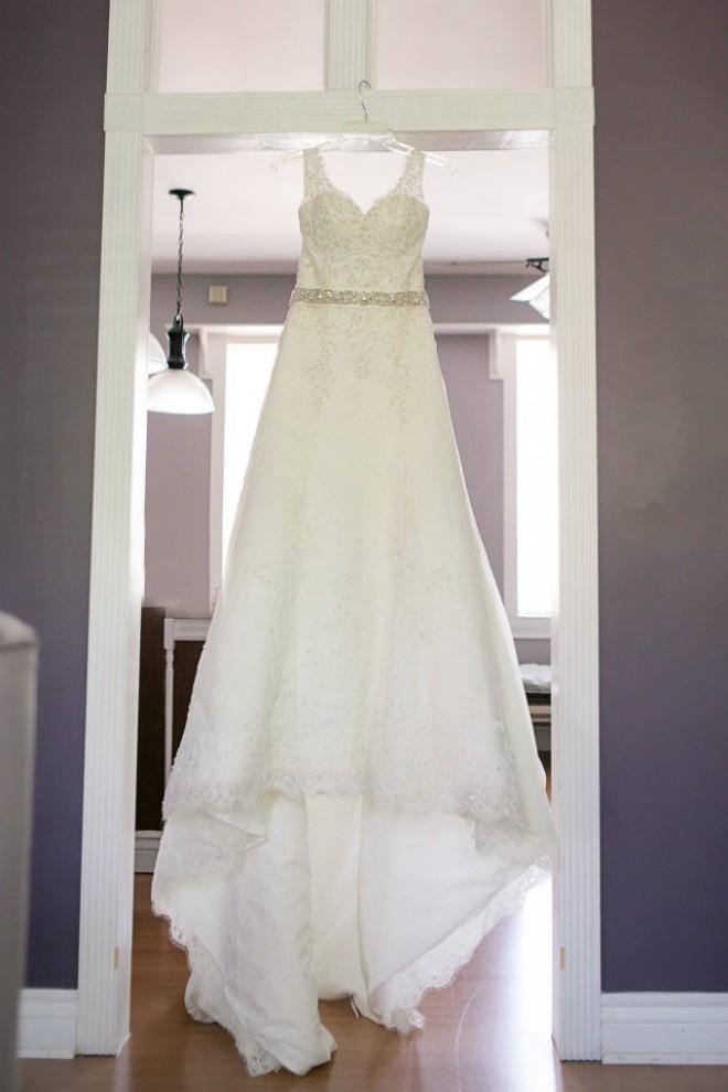 Keeton's wedding dress. - PHOTO COURTESY OF TWO WHITE DOORS PHOTOGRAPHY.