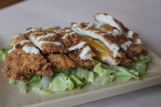 """Volcano Chicken,"" one of the most popular appetizers, is fried chicken stuffed with American cheese. - PHOTO BY SARAH FENSKE"