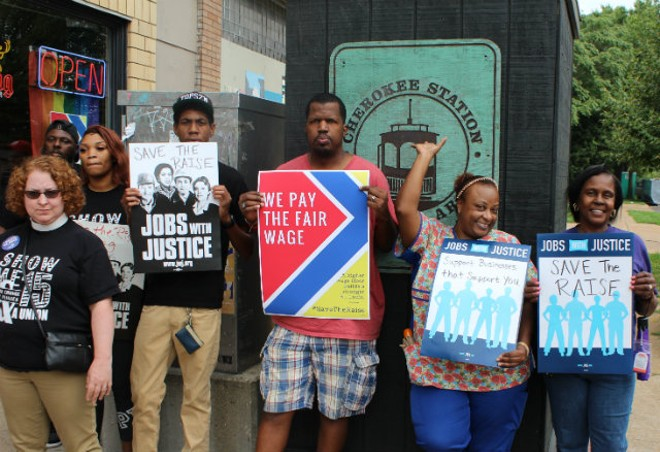 Activists who support a higher minimum wage advocated at today's press conference. - PHOTO BY QUINN WILSON