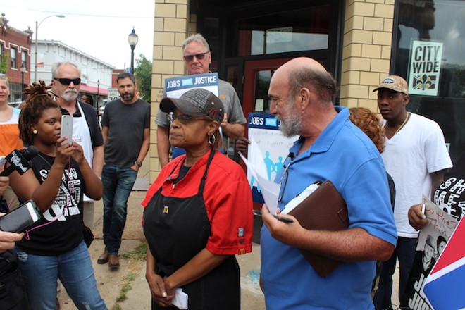 Lew Prince, right, looks on as Betty Douglas address reporters. Her employer, McDonald's, has not joined the campaign. - PHOTO BY QUINN WILSON