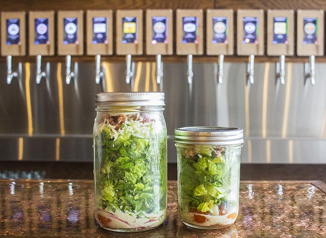 """he """"Tapped Mason Jar Salad"""" comes in two sizes with romaine lettuce, bacon, egg, red onion, tomato, a four-cheese blend and house vinaigrette. - PHOTO BY MABEL SUEN"""