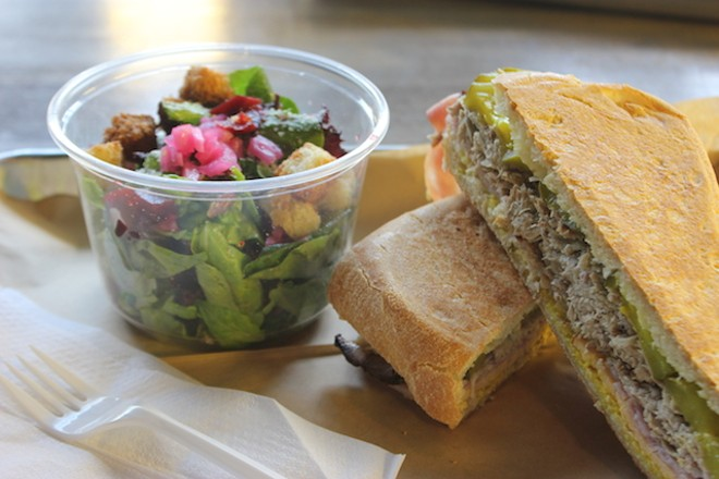 """The """"Cubano"""" sandwich with a side salad is among seven sandwich offerings on the current menu. - PHOTO BY SARAH FENSKE"""