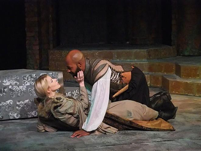 Queen Tamora (Suki Peters) romances her secret paramour, Aaron (Darrious Varner). - RON JAMES