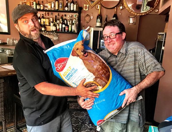 Tom Halaska and Stephen Zettl wrangle donations. - KELLI MCCULLEN