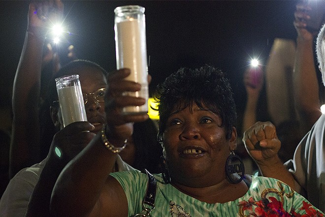 Annie Smith at a candlelight vigil for her son Monday night. - PHOTO BY DANNY WICENTOWSKI