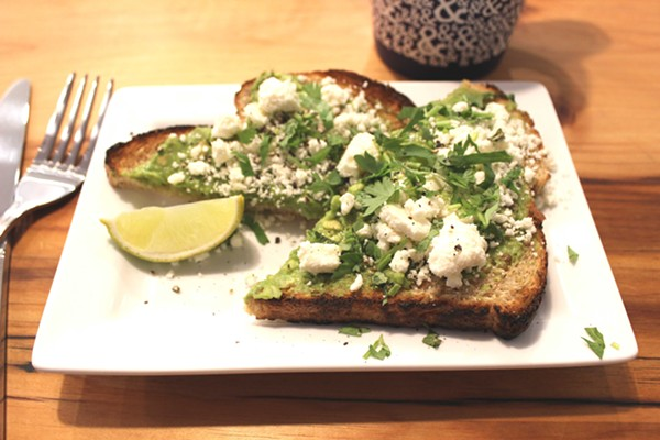 Half & Half's take on avocado toast features cilantro and feta cheese. - PHOTO BY LAUREN MILFORD